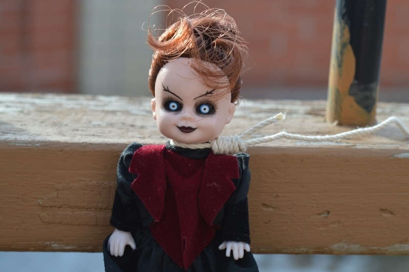 are curses real doll